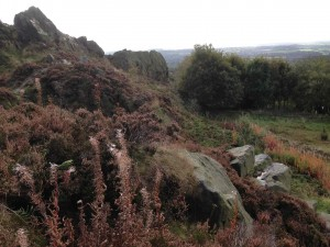 Mow Cop rocks with the Cheshire plain in the background