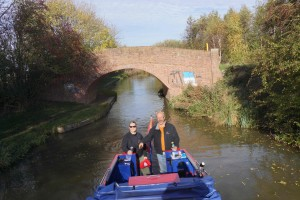Pat and Kerry revisiting travel under Pat's Bridge- on the Grand Union Canal