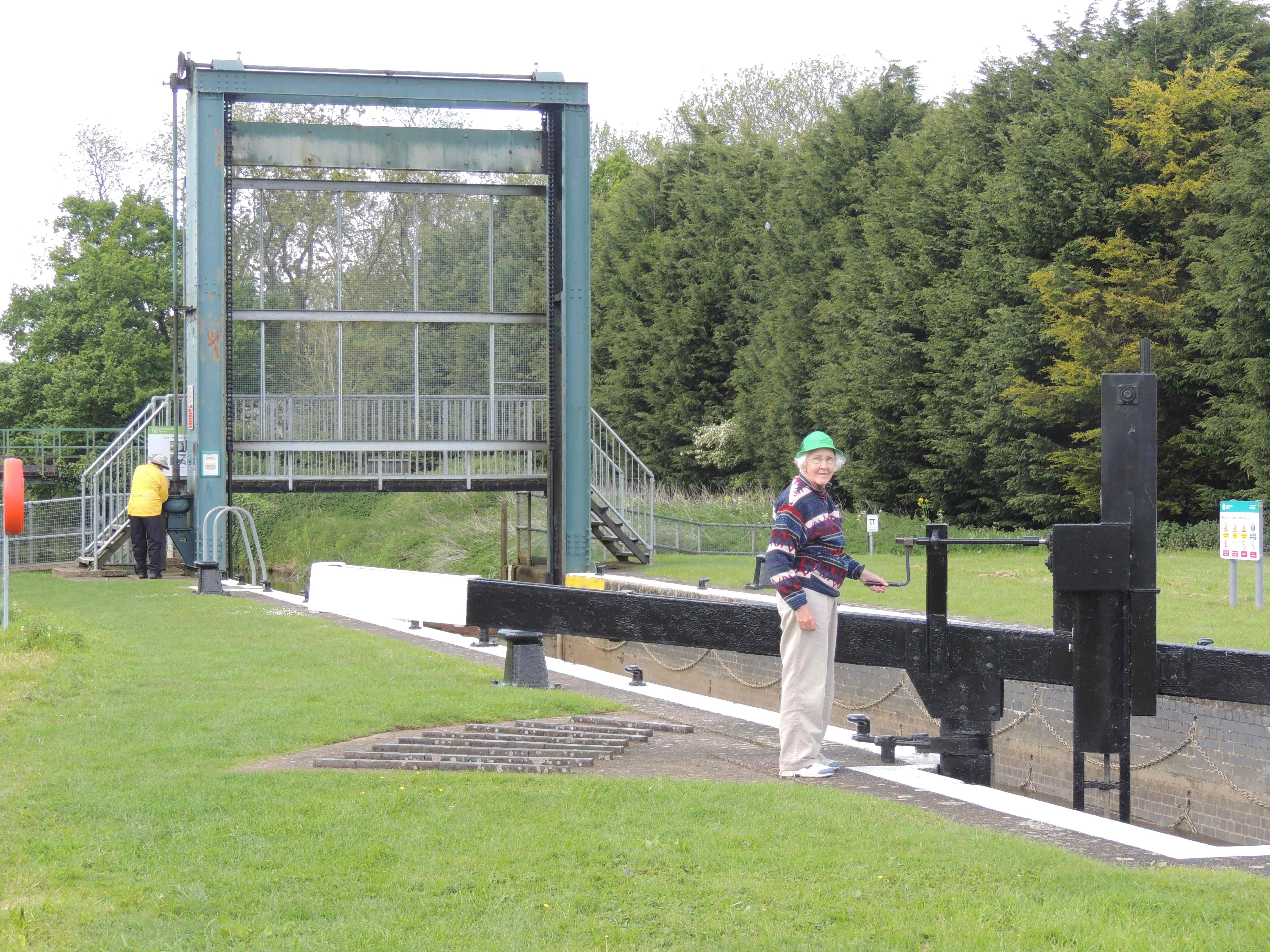 chuck and Lois operating the guillotine gate locks on the Nene River